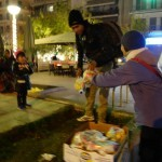 20151212 refugees are blissful happy to receive our foods and flyer at midnight at Victory Park in Athens Greece (1)