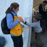 Little boy shows his gratefulness with his orange, Idomeni, Greece
